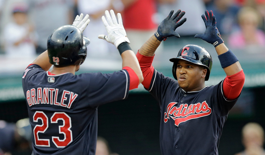 . Cleveland Indians\' Jose Ramirez, right, is congratulated by Michael Brantley after they scored on Ramirez\'s two-run home run off San Diego Padres starting pitcher Dinelson Lamet during the first inning of a baseball game, Thursday, July 6, 2017, in Cleveland.(AP Photo/Tony Dejak)