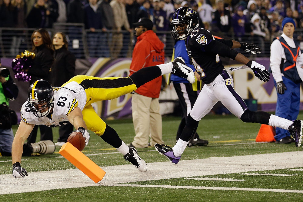 . Tight end Heath Miller #83 of the Pittsburgh Steelers scores a touchdown after catching a pass in front of cornerback Corey Graham #24 of the Baltimore Ravens during the fourth quarter of the Steelers 23-20 win at M&T Bank Stadium on December 2, 2012 in Baltimore, Maryland.  (Photo by Rob Carr/Getty Images)