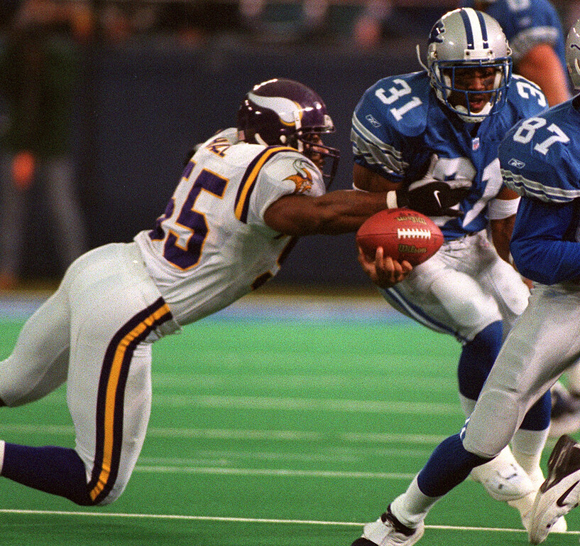 . With Minnesota Viking linebacker Lemanski Hall (left) tackling, Detroit Lions running back Aveion Cason fumbles the ball in the first quarter of the Lions\'  27-24  victory at the Silverdome Sunday.  The ball was picked up and returned for a touchdown by the Vikings Tyrone Carter.