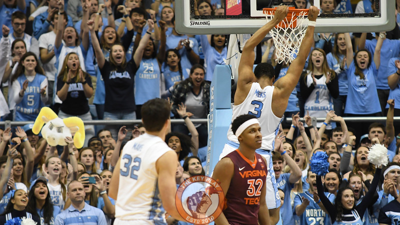 Virginia Tech Hokies forward Zach LeDay (32) and Carolina fans react following an uncontested dunk by Tar Heels forward Kennedy Meeks (3). (Michael Shroyer/ TheKeyPlay.com)