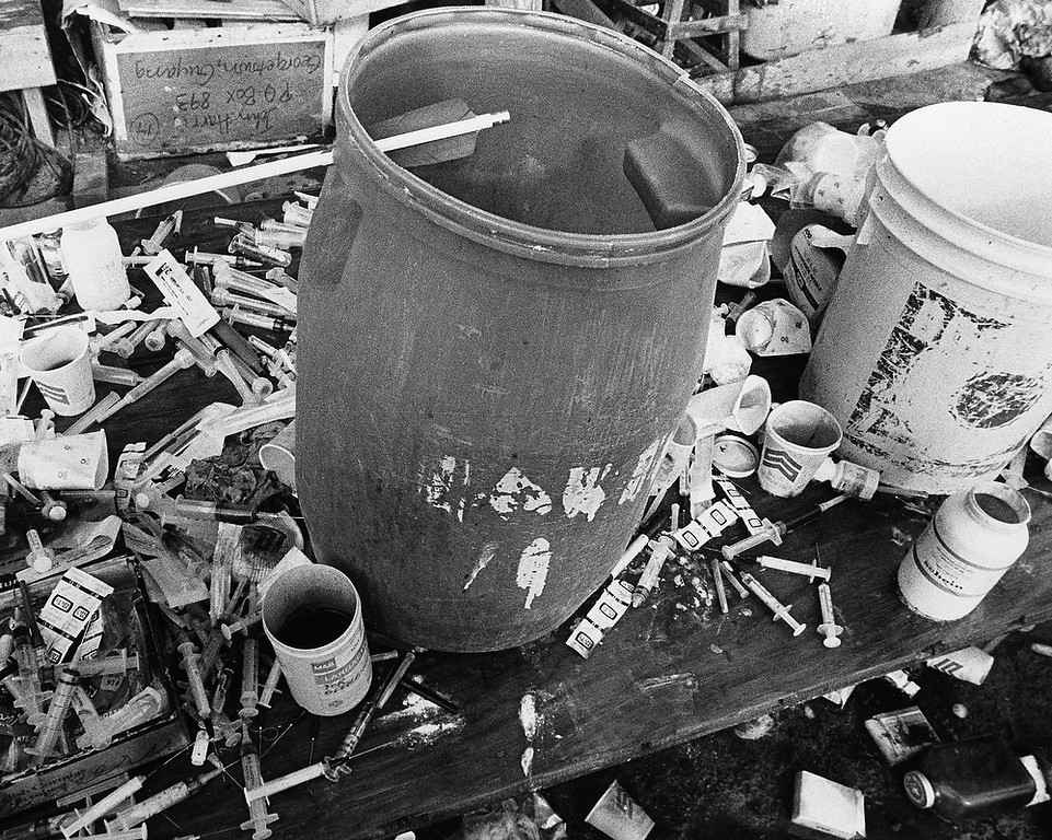 . Syringes surround one of the vats used to mix the drink used in a mass suicide for more than 900 people at the religious cult town of Jonestown, Guyana on Nov. 26, 1978. Leader Jim Jones lead the group claiming they would be transported to another planet where they would live in peace in a new eden avoiding the nuclear fire that would engulf the earth. (AP Photo/Val Mazzenga)
