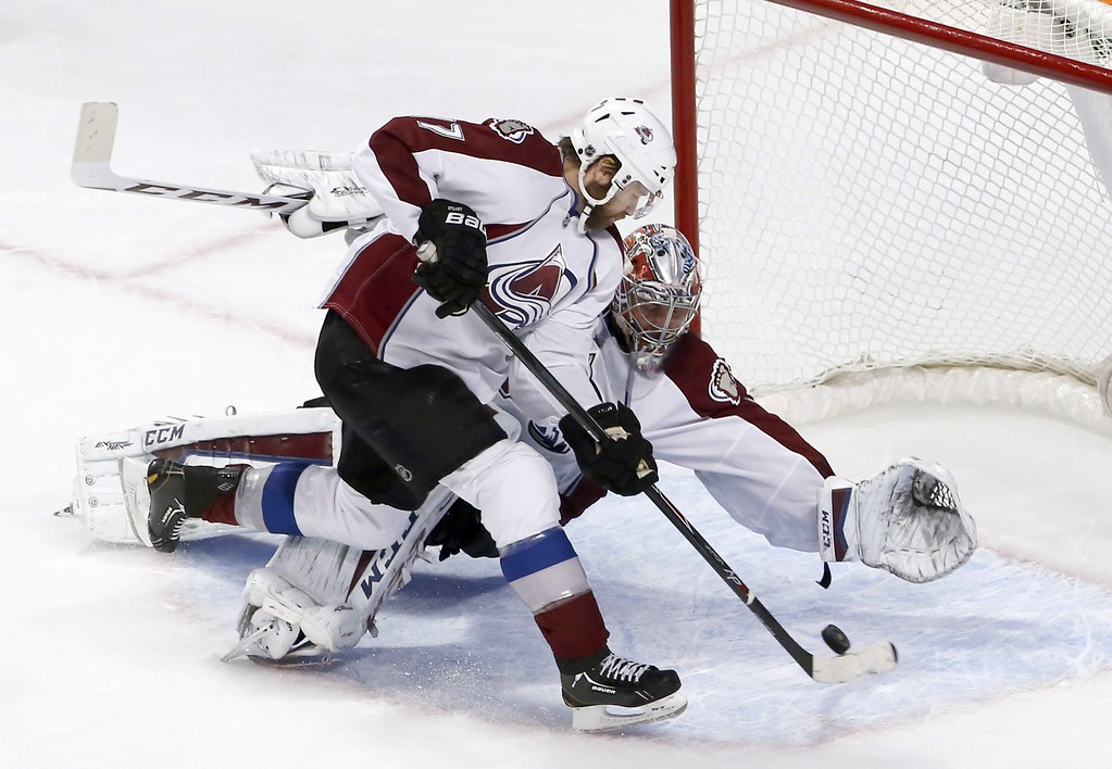 . Colorado Avalanche goalie Semyon Varlamov gets defensive help from Brad Stuart (17) during the second period of an NHL hockey game against the Chicago Blackhawks Tuesday, Jan. 6, 2015, in Chicago. (AP Photo/Charles Rex Arbogast)