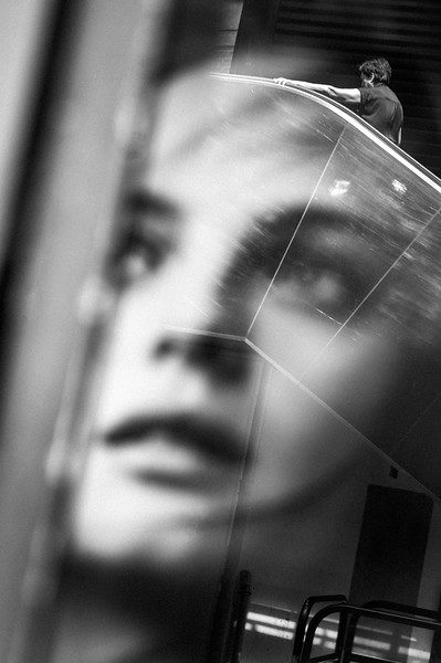 NIMES_MECHANIC_STAIRS_LADY_THRU_MODEL_REFLECTION.jpg