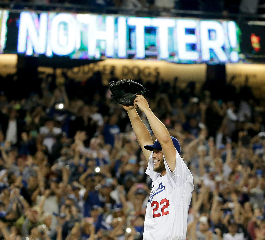 . Los Angeles Dodgers starting pitcher Clayton Kershaw celebrates his no hitter against the Colorado Rockies after a baseball game in Los Angeles, Wednesday, June 18, 2014. Kershaw also struck out a career-high 15 batters. (AP Photo/Chris Carlson)