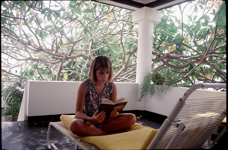 Alissa reading A Tale of Two Cities at Peponi Hotel, Lamu
