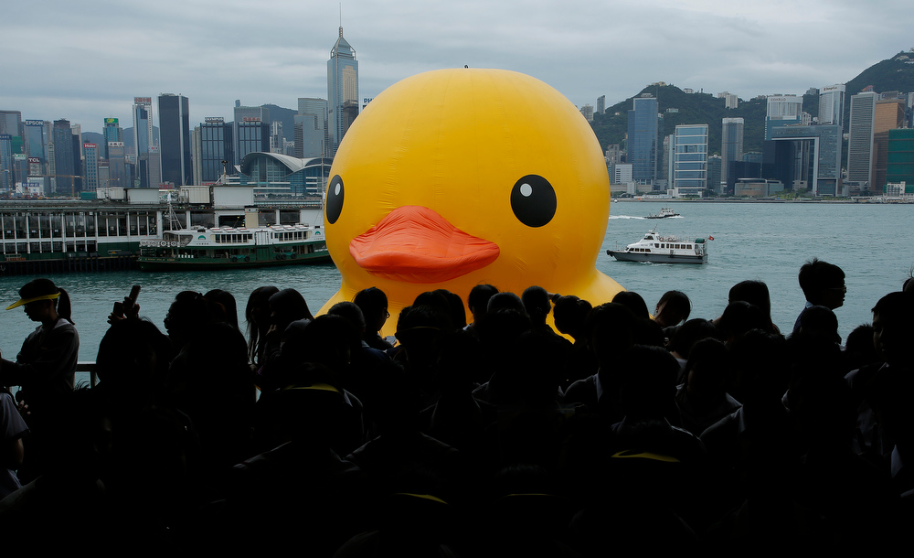 . A 16.5-meter(650-inch)-high giant Rubber Duck created by Dutch artist Florentijn Hofman is towed along Hong Kong\'s Victoria Habour Thursday, May 2, 2013. Since 2007 the Rubber Duck has traveled to various cites including Osaka, Sydney, Sao Paulo and Amsterdam. (AP Photo/Vincent Yu)