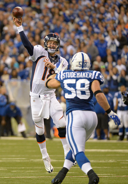 . Denver Broncos quarterback Peyton Manning (18) throws a pass over Indianapolis Colts linebacker Andy Studebaker (58) during the third quarter October 20, 2013 at Lucas Oil Field. Photo by John Leyba/The Denver Post)