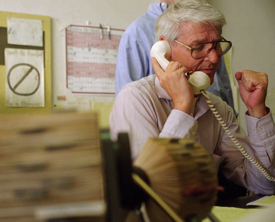 . David Collins clenches his fist as Allegan County, Mich., authorities tell him they are calling off the two-day search for his son, Kevin, Thursday, Oct. 27, 1994, in San Francisco, Calif.  Hopes for a break in the case came with an anonymous tip from an alleged priest who said he took the confession of a San Quentin inmate who claimed to have kidnapped, killed and buried Kevin in southwestern Michigan. (AP Photo/Sam Morris)