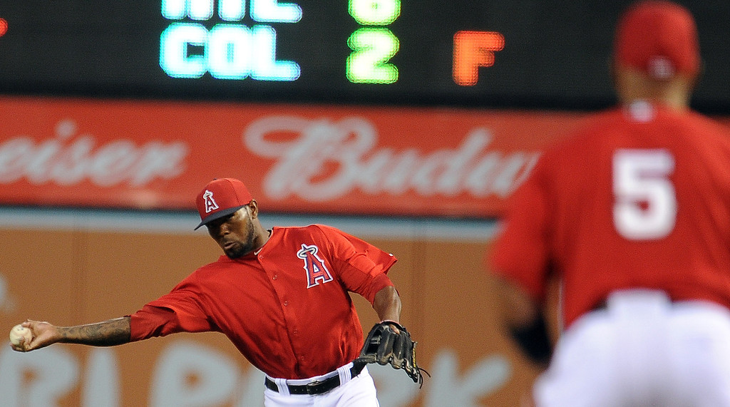 . Los Angeles Angels second baseman Howard Kendrick throws out Los Angeles Dodgers\' Andre Ethier (not pictured) in the first inning of a spring baseball game on Thursday, March 28, 2012 in Anaheim, Calif.   (Keith Birmingham/Pasadena Star-News)