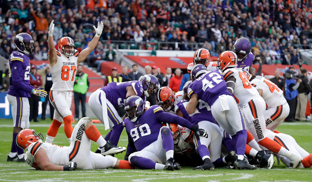 . Cleveland Browns quarterback DeShone Kizer (7) scores on a 1-yard touchdown run during the first half of an NFL football game against Minnesota Vikings at Twickenham Stadium in London, Sunday Oct. 29, 2017. (AP Photo/Matt Dunham)