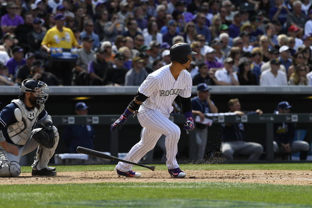 . Carlos Gonzalez (5) of the Colorado Rockies hits an RBI double, sending home DJ LeMahieu (9) in the second inning. The Colorado Rockies played the San Diego Padres Friday, April 8, 2016 on opening day at Coors Field in Denver, Colorado. (Photo By Andy Cross/The Denver Post)