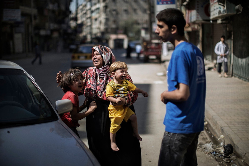 . Members of a Syrian family cry outside a hospital after surviving a strike by Syrian regime forces in the Sheikh Fares district of the northern city of Aleppo on September 18, 2012. Syrian troops shelled several districts in Aleppo and clashed with rebels, as Damascus ally Iran proposed a simultaneous halt to the violence and a peaceful solution to the conflict. MARCO LONGARI/AFP/Getty Images