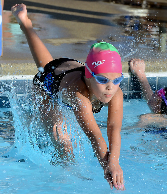. Harleysville girls 8 and under compete in a free relay event against Hatfield during their BuxMont Swim meet  at the Harleysville Community Pool on Thursday July 17,2014.Photo by Mark C Psoras/The Reporter