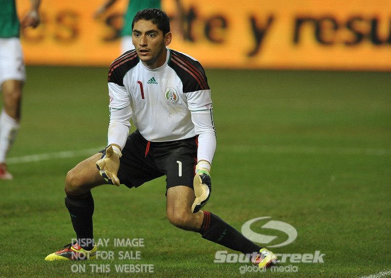 Mexico's Goalkeeper Jesus Corona (#1) waits for the ball to come to him in Soccer action between Bosnia-Herzegovina and Mexico.  Mexico defeated Bosnia-Herzegovina 2-0 in the game at the Georgia Dome in Atlanta, GA.