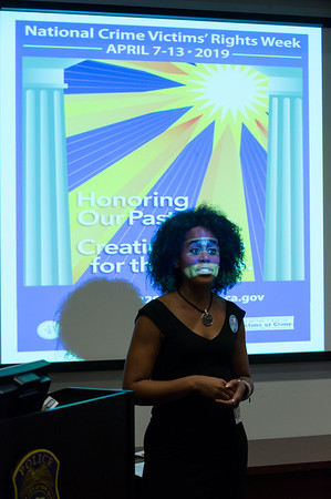04/08/19 Wesley Bunnell   Staff Marlo Greponne, Director of Planning and Programs for HRA, stands in front of a projection screen commemorating this week as National Crime Victim's Rights Week. A kick off event was held on Monday afternoon at the New Britain Police Station.