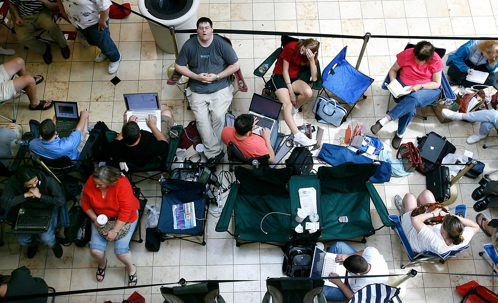 . Customers wait in line for the release of the new Apple iPhone  at Woodland Hills Mall in Tulsa, Okla., on Friday, June 29, 2007. (AP Photo/David Crenshaw)