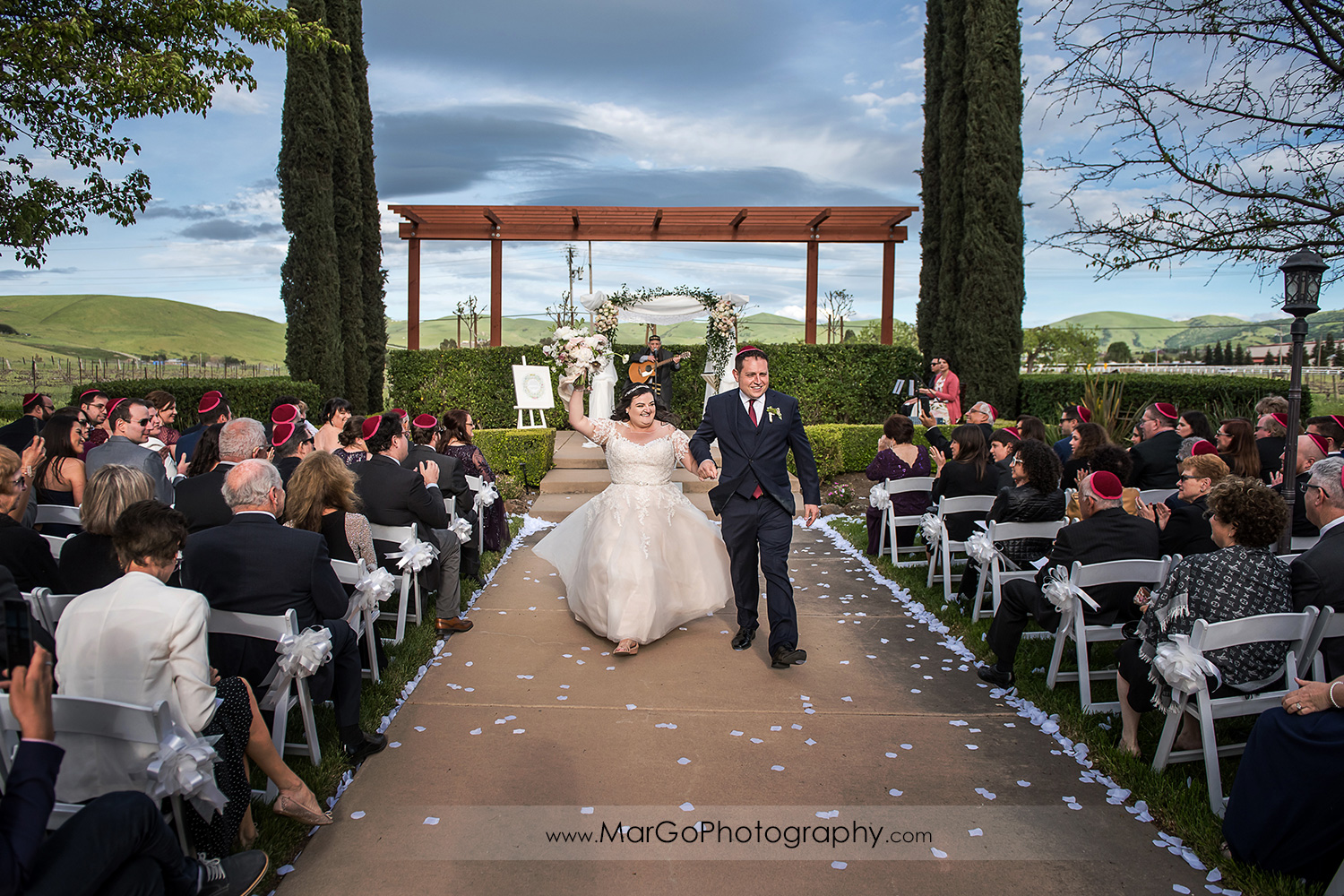 bride and groom walking down the aisle after jewish wedding ceremony at Livermore Garre Vineyard and Winery
