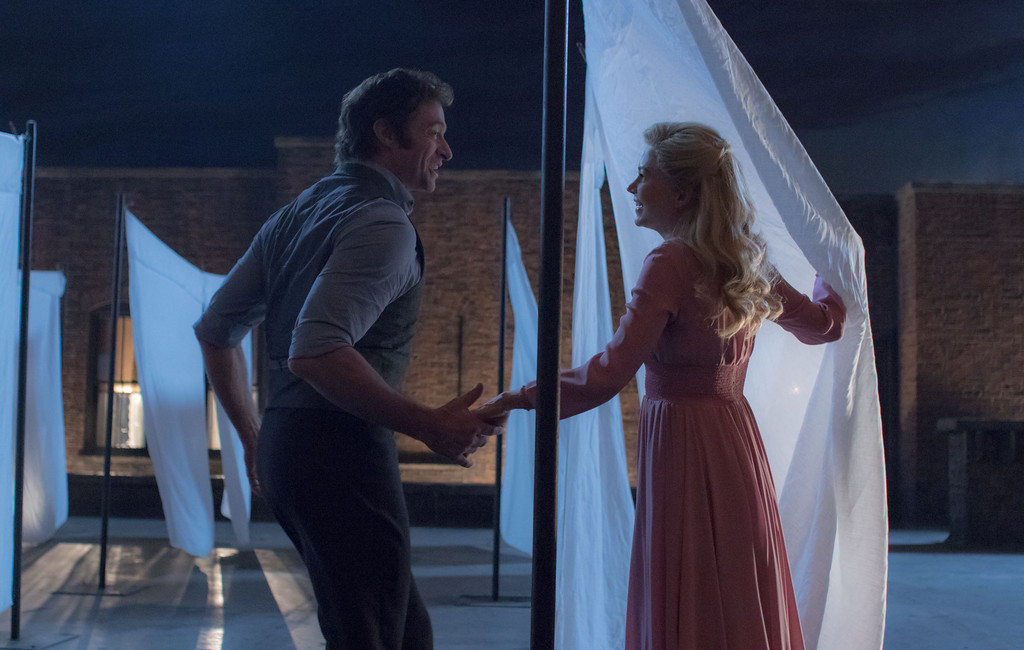 ". Hugh Jackman portrays P.T. Barnum, and Michelle Williams his his wife, Charity, in ""The Greatest Showman.\"" The movie is in theaters now. (Twentieth Century Fox)"