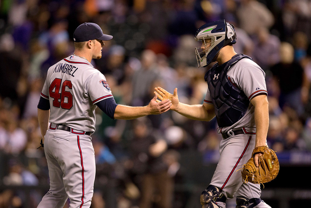 . Craig Kimbrel #46 and Evan Gattis #24 of the Atlanta Braves celebrate their 3-1 win against the Colorado Rockies at Coors Field on June 9, 2014 in Denver, Colorado.  (Photo by Justin Edmonds/Getty Images)