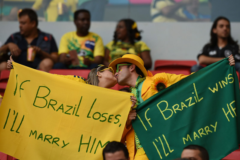 . Brazilian fans kiss before the start of the third place play-off football match between Brazil and Netherlands during the 2014 FIFA World Cup at the National Stadium in Brasilia on July 12, 2014. (VANDERLEI ALMEIDA/AFP/Getty Images)