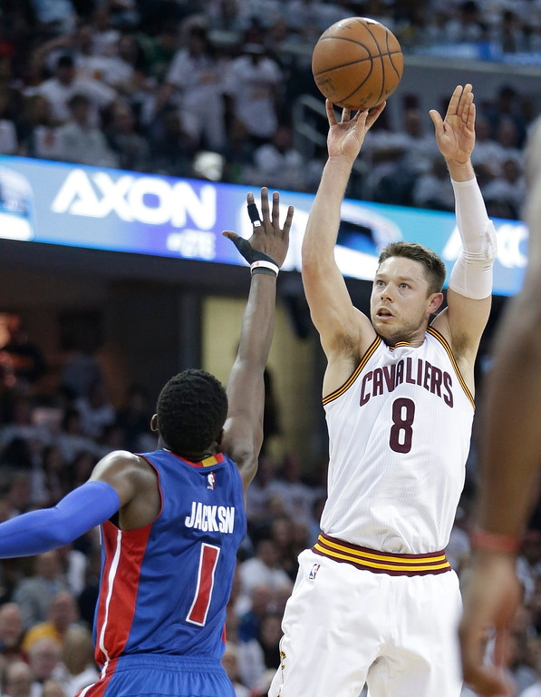 . Cleveland Cavaliers\' Matthew Dellavedova (8) shoots over Detroit Pistons\' Reggie Jackson (1) during the first half in Game 2 of a first-round NBA basketball playoff series, Wednesday, April 20, 2016, in Cleveland. The Cavaliers won 107-90. (AP Photo/Tony Dejak)