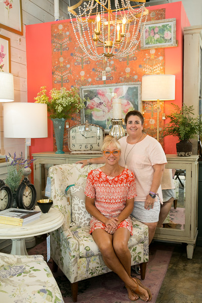 Stephanie Nieuwendijk-Bramble, left, is the owner and creative director at Dutchmans Designs.  Mary-Lamont Roberts is the Chamblee store manager.  They have sister stores in St. Simons and Highlands, NC.  The solid wooden furniture is customized stylishly.  Lighting fixtures and options are mixed in with textured fabrics, sophisticated colors and quality design.  (Jenni Girtman / Atlanta Event Photography