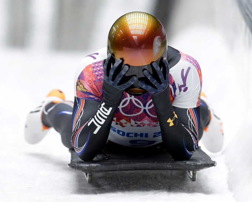 . John Daly of the United States puts his head in his hands after a bad final run that dropped him out of medal contention during the men\'s skeleton competition at the 2014 Winter Olympics, Saturday, Feb. 15, 2014, in Krasnaya Polyana, Russia. (AP Photo/Natacha Pisarenko)