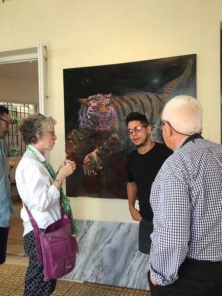 Irene and Gabriel talk with artist Orlando Almanza - Kristin Cass