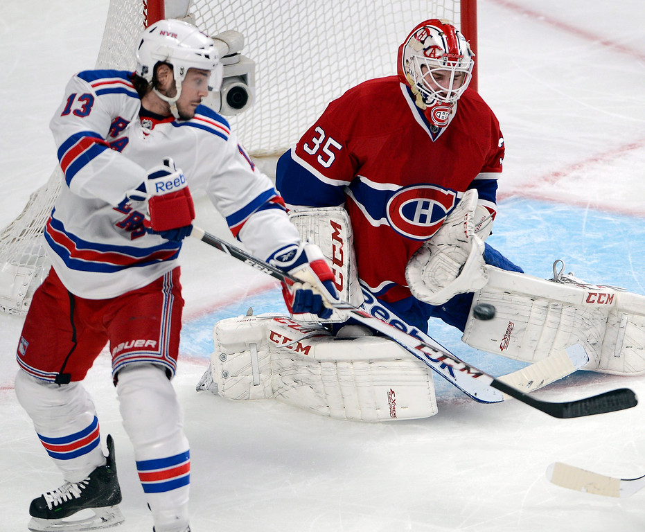 . Montreal Canadiens goalie Dustin Tokarski (35) stops New York Rangers left wing Daniel Carcillo (13) during the second period in Game 2 of the NHL hockey Eastern Conference final Stanley Cup playoff series Monday, May 19, 2014, in Montreal. (AP Photo/The Canadian Press, Ryan Remiorz)