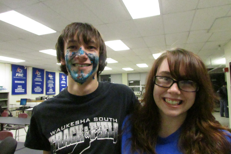 Celebrating Erik's birthday by painting Max's face with frosting