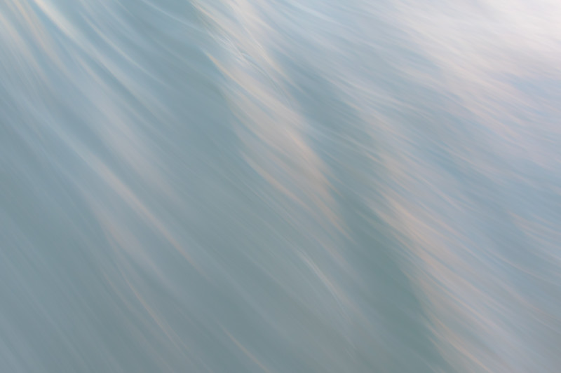 Ocean waves are blurred thanks to the use of a slow shutter speed