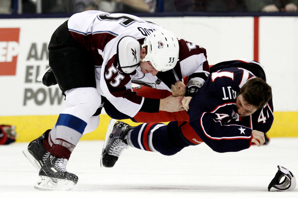 . Colorado Avalanche\'s Cody McLeod, left, fights with Columbus Blue Jackets\' Dalton Prout in the second period of an NHL hockey game in Columbus, Ohio, Sunday, March 3, 2013. (AP Photo/Paul Vernon)