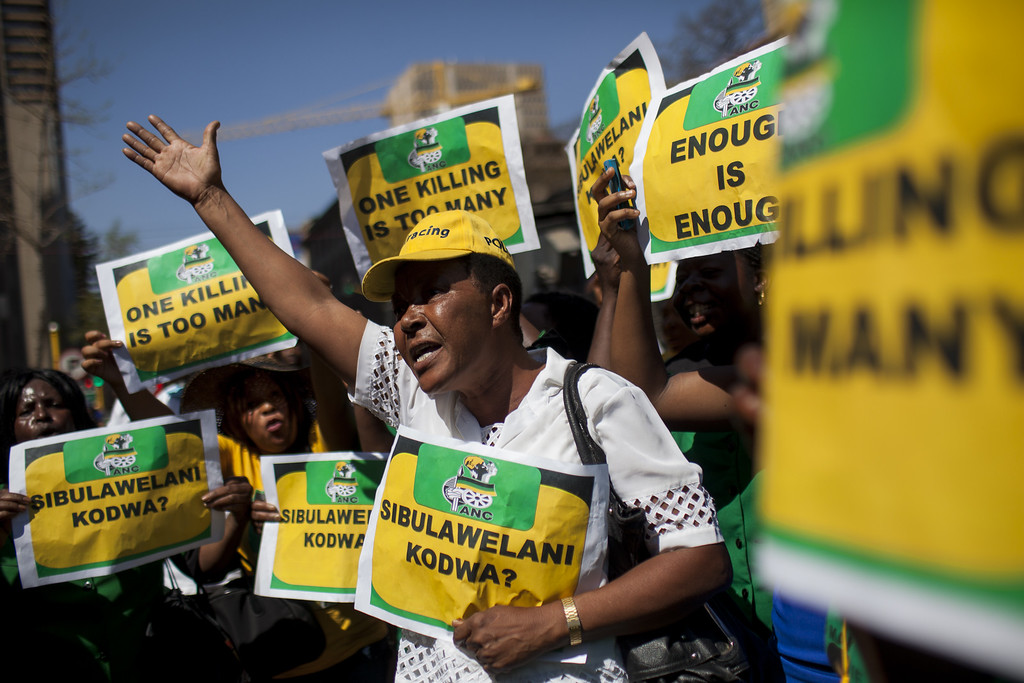 . Members of the ANC Women\'s League protest Oscar Pistorius outside the North Gauteng High Court on September 11, 2014 in Pretoria, South Africa.  (Charlie Shoemaker/Getty Images)