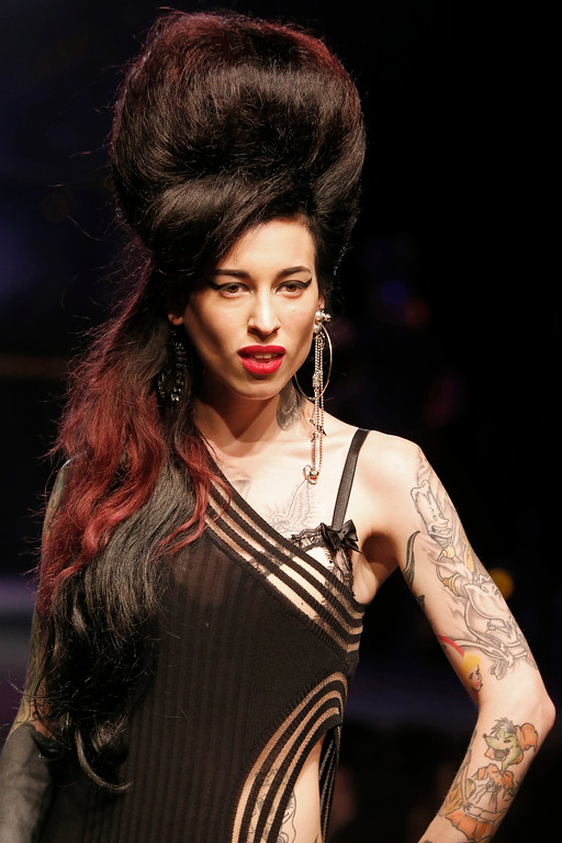 . A model presents a creation as part of Jean-Paul Gaultier\'s ready-to-wear Spring/Summer 2014 fashion collection, presented Saturday, Sept. 28, 2013 in Paris. (AP Photo/Jacques Brinon)