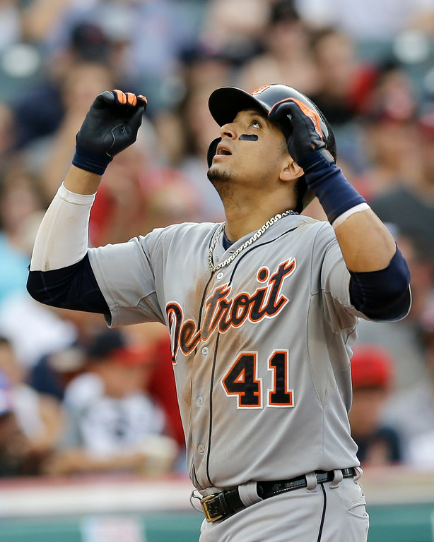 . Detroit Tigers\' Victor Martinez looks up after hitting a two-run home run off Cleveland Indians starting pitcher Corey Kluber in the third inning of a baseball game, Monday, Sept. 1, 2014, in Cleveland. Miguel Cabrera scored on the play. (AP Photo/Tony Dejak)