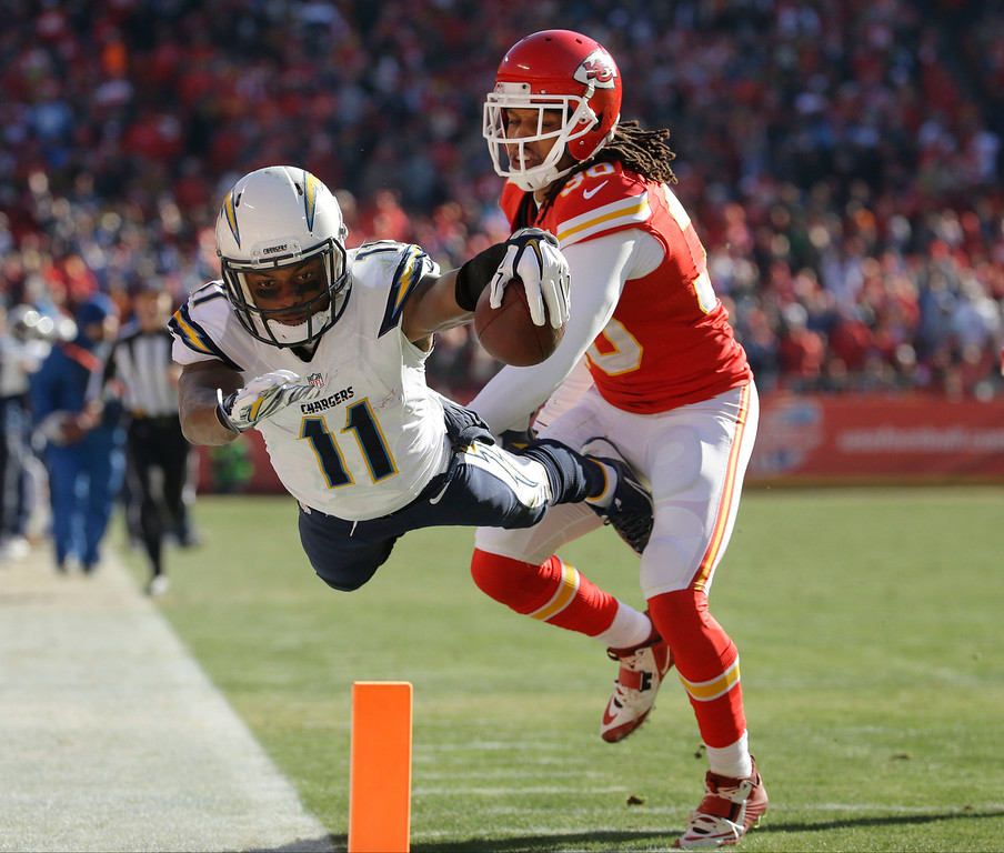 . San Diego Chargers wide receiver Eddie Royal (11) is pushed out of bounds by Kansas City Chiefs defensive back Jamell Fleming (30) before reaching the end zone, during the first half of an NFL football game in Kansas City, Mo., Sunday, Dec. 28, 2014. (AP Photo/Charlie Riedel)