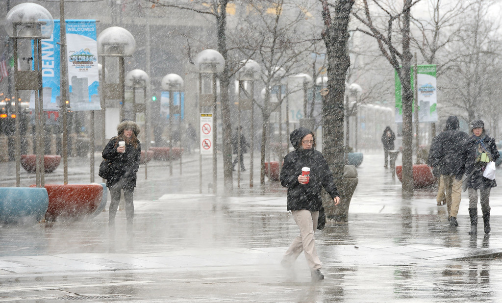 . DENVER, CO - FEBRUARY  25: Snow began to fall again  in the afternoon in Denver on Wednesday, February 25, 2015.   Walkers carrying warm  beverages in hand, battle the snow walking across  Broadway at 16th Street in downtown Denver. (Photo by Cyrus McCrimmon/The Denver Post )