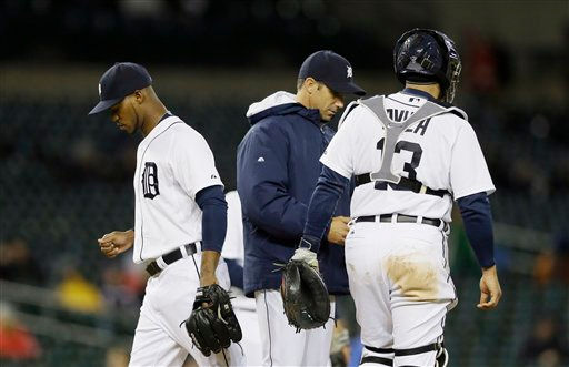 . Detroit Tigers relief pitcher Al Alburquerque is relieved during the seventh inning of a baseball game against the New York Yankees, Tuesday, April 21, 2015, in Detroit. (AP Photo/Carlos Osorio)