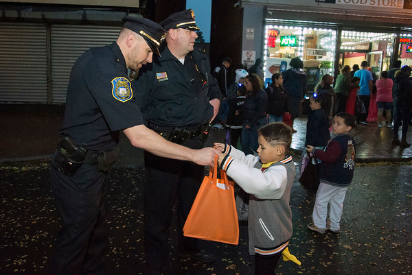 10/31/19 Wesley Bunnell | StaffrrPolice Capt. Adam Rembisz passes out candy to a trick or treater at the New Britain Down District Halloween Safe Zone 2019.