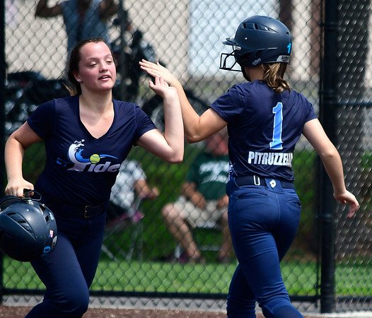 7/28/2018 Mike Orazzi | Staff CT Tides White's Dana Boothroyd (55) and Ava Pitruzzello (1) at Chesley Park in New Britain Saturday afternoon.
