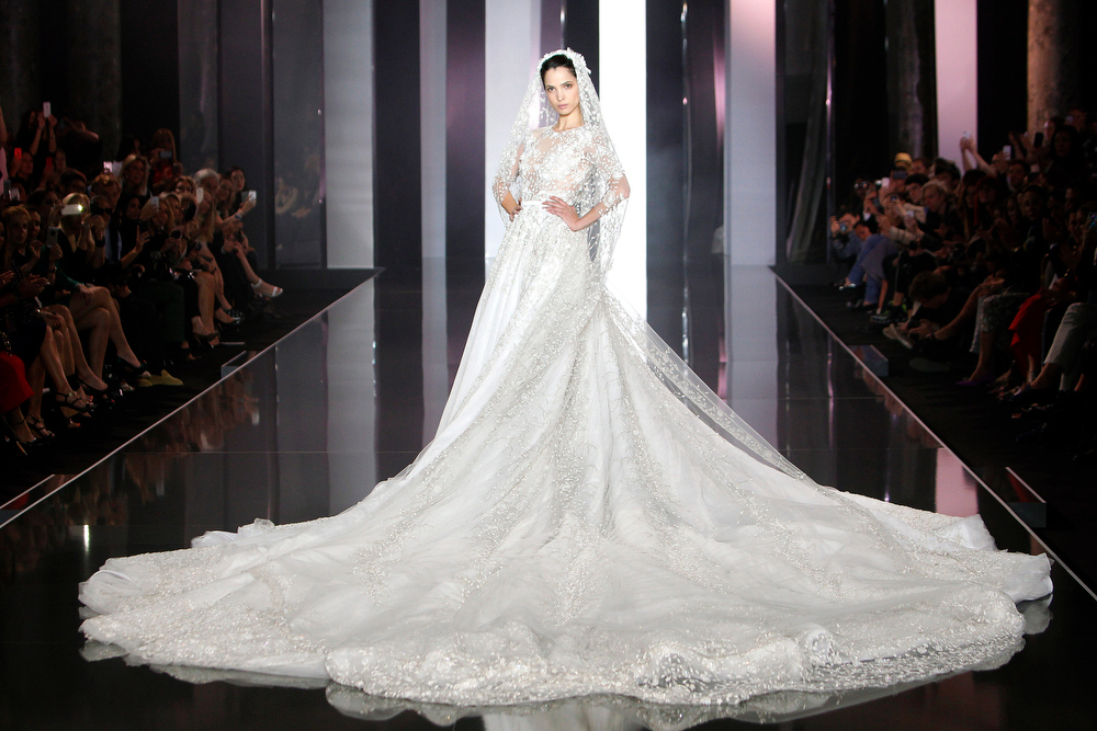 . A Models wears the wedding gown for Ralph & Russo\'s fall-winter 2014-2015 Haute Couture fashion collection presented in Paris, France, Thursday, July 10, 2014. (AP Photo/Thibault Camus)