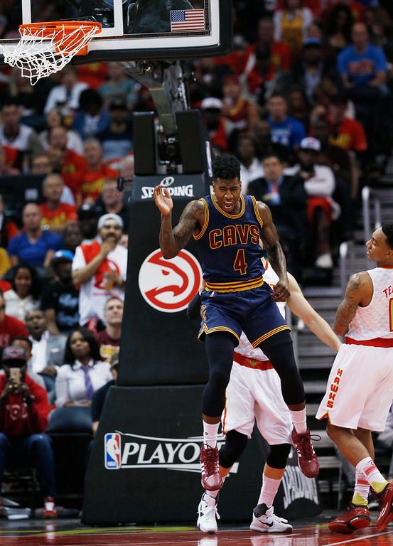 . Cleveland Cavaliers guard Iman Shumpert (4) celebrates his dunk against the Atlanta Hawks in the first half of Game 3 of the second-round NBA basketball playoff series, Friday, May 6, 2016, in Atlanta. (AP Photo/John Bazemore)