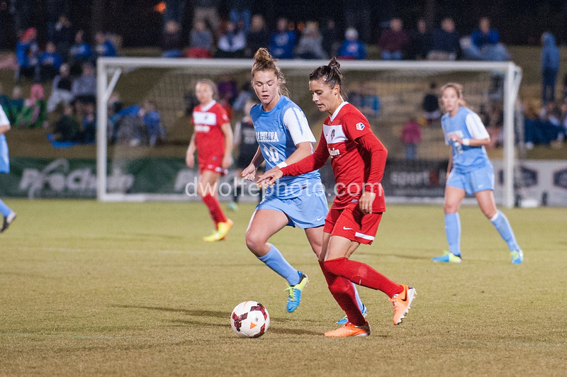 Jo Boyles of UNC stays with Ali Krieger, looking to find an opportunity to steal the ball.
