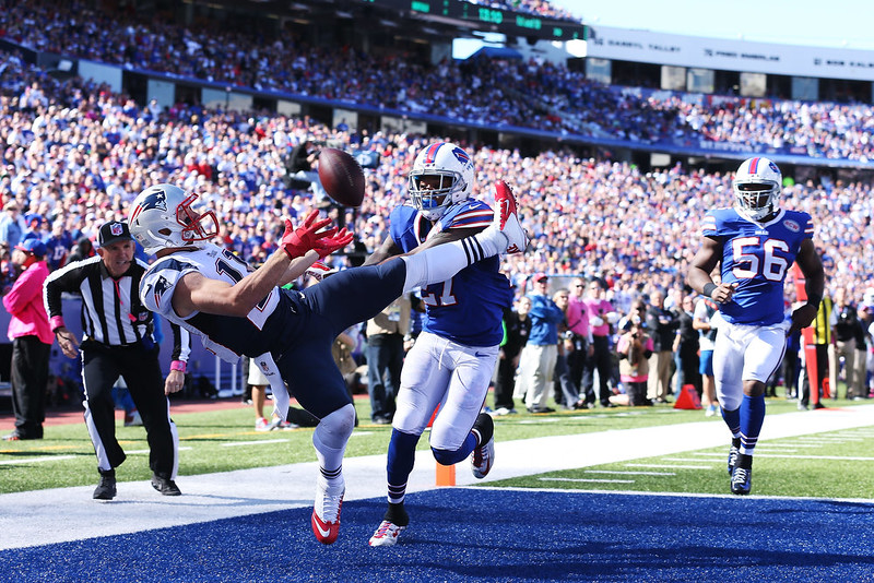 . Julian Edelman #11 of the New England Patriots tries to catch a pass in the endzone while defended by Duke Williams #27 of the Buffalo Bills during the first half at Ralph Wilson Stadium on October 12, 2014 in Orchard Park, New York. Williams was called for pass interference on the play. (Photo by Brett Carlsen/Getty Images)