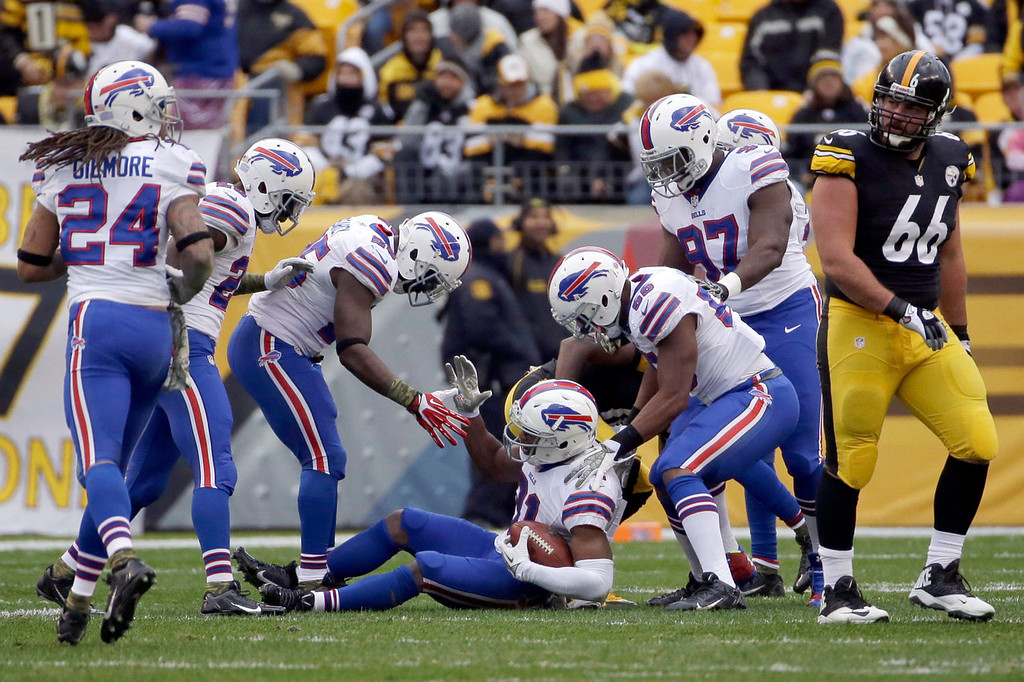 . Buffalo Bills\' Jairus Byrd, center,  celebrates with teammates after intercepting a pass during the first half of an NFL football game as Pittsburgh Steelers guard David DeCastro (66) walks away, Sunday, Nov. 10, 2013, in Pittsburgh. (AP Photo/Gene J. Puskar)