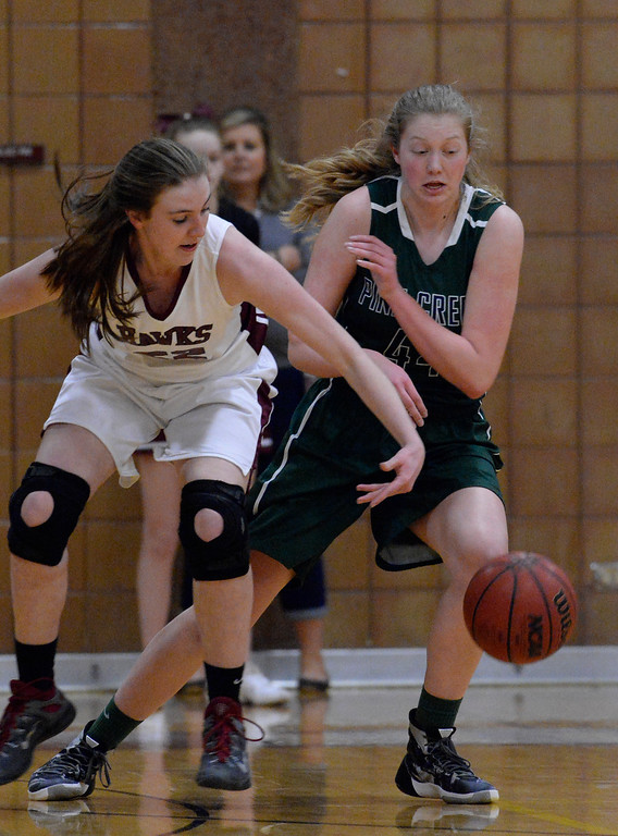. THORNTON, CO - MARCH 01: Pine Creek Courtney Stanton (44) knocks the ball away from Horizon Samantha Deem (22) during the first quarter in the Girls Class 5A Sweet 16 game March 1, 2016 at Horizon HS. (Photo By John Leyba/The Denver Post)