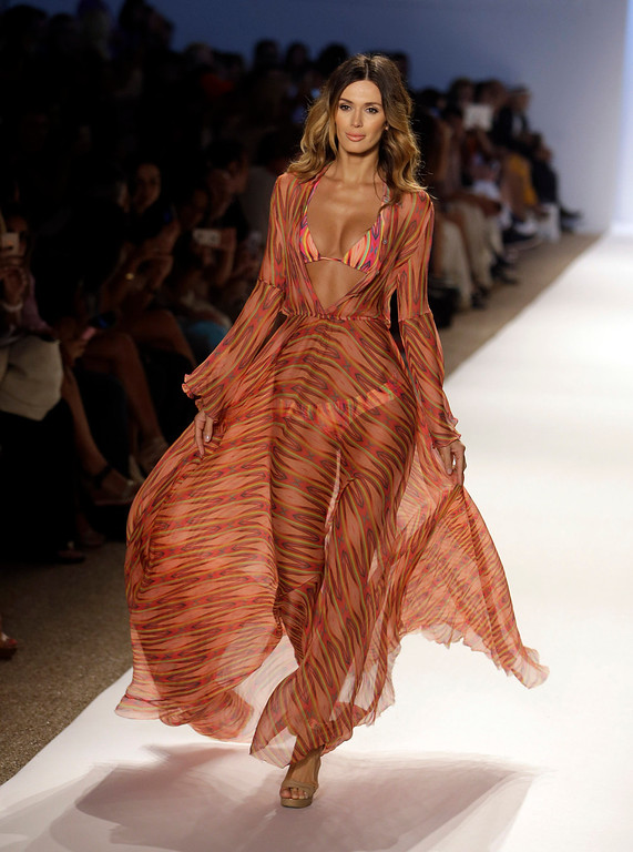 . A model walks the runway during the Cia.Maritima show at the Mercedes-Benz Fashion Week Swim 2014, Saturday, July 20, 2013, in Miami Beach, Fla. (AP Photo/Lynne Sladky)