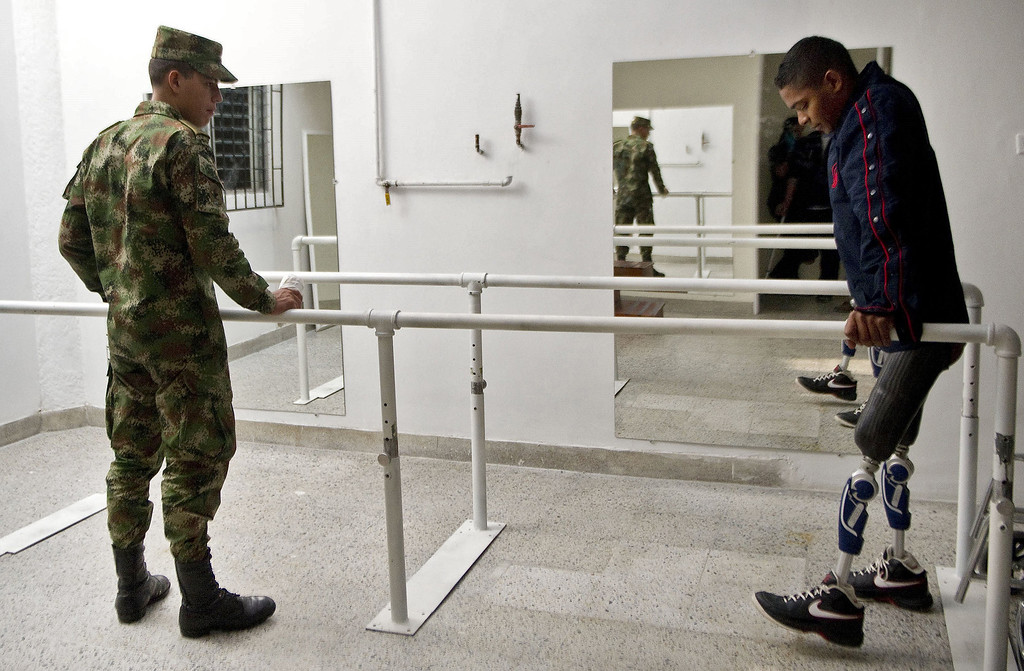 . Colombian soldier Mario Ballesteros, victim of a land mine explosion 15 months ago, tries his new prosthesis at the hospital.  RAUL ARBOLEDA/AFP/Getty Images