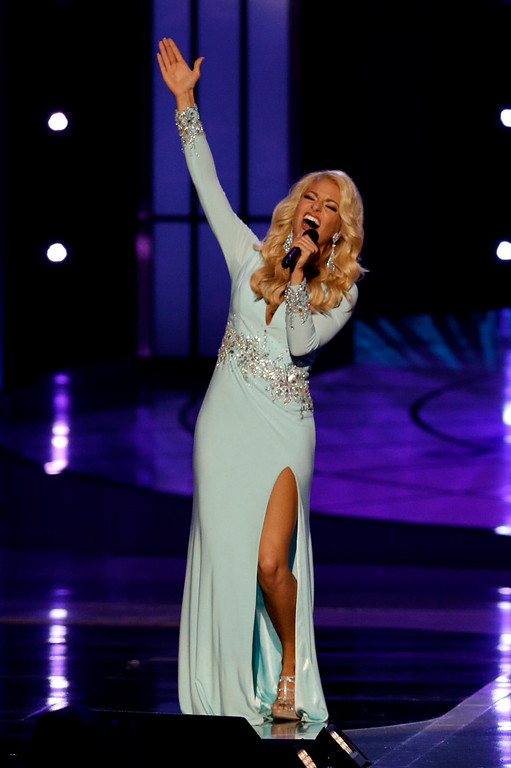 . Miss Tennessee Hayley Lewis sings during the talent portion of the Miss America 2015 pageant, Sunday, Sept. 14, 2014, in Atlantic City, N.J. (AP Photo/Mel Evans)
