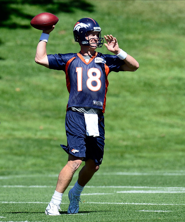 . Denver Broncos quarterback Peyton Manning (18) drops back to pass during OTA\'s May 30, 2013 at Dove Valley. (Photo By John Leyba/The Denver Post)
